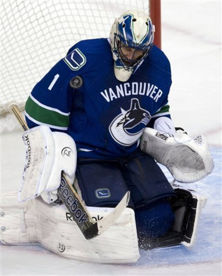 Vancouver Canucks goalie Roberto Luongo (1) makes a save against the Nashville Predators during the second period of their NHL hockey game, Thursday, March,14, 2013, in Vancouver. (AP Photo/The Canadian Press, Jonathan Hayward)