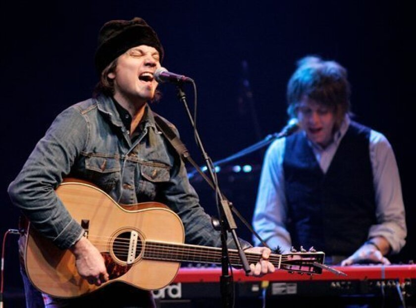 FILE - In this Dec. 7, 2007 file photo, Jeff Tweedy, left, and Pat Sansone of Wilco perform at a fundraising concert for then Democratic presidential hopeful Sen. Barack Obama, D-Ill., in Chicago. (AP Photo/Brian Kersey, file)