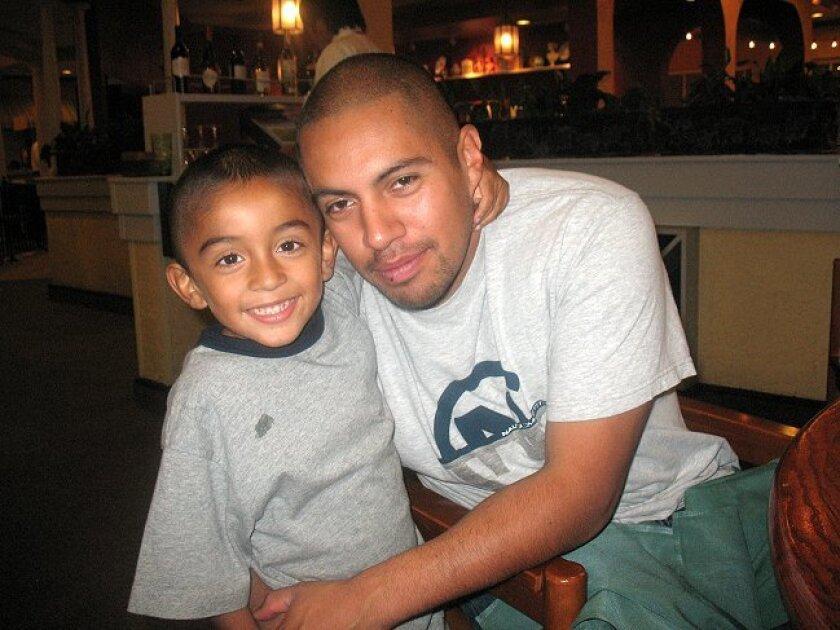 Oscar Lopez is seen with his son Oscar Jr.