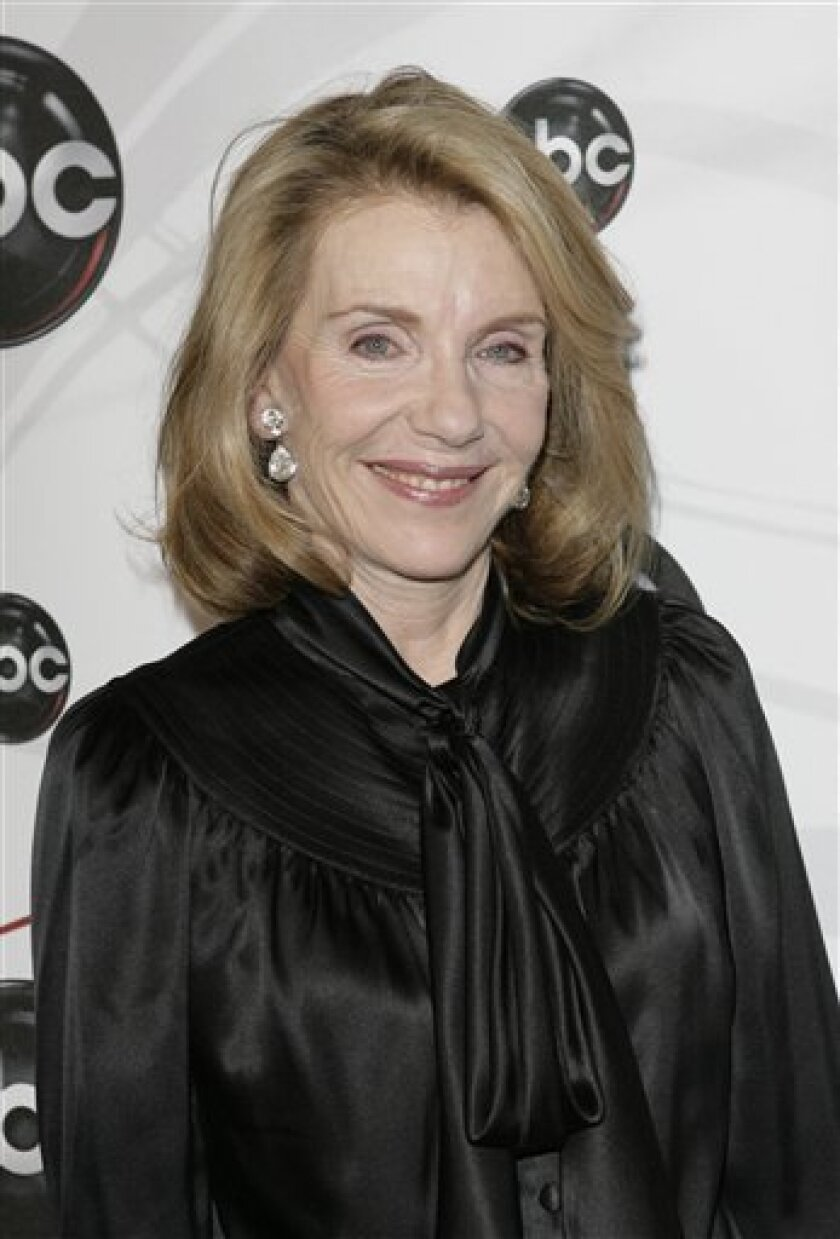 """FILE - In this May 15, 2007 file photo, Jill Clayburgh, star of """"Dirty Sexy Money"""" poses for photographers on the red carpet during the arrivals of ABC's 2007-2008 preview in New York. In one of her final roles Jill Clayburgh plays the mom of charismatic Viagra salesman Jamie Reidy (Jake Gyllenhaal) in the romantic comedy """"Love and Other Drugs."""" (AP Photo/Seth Wenig, File)"""