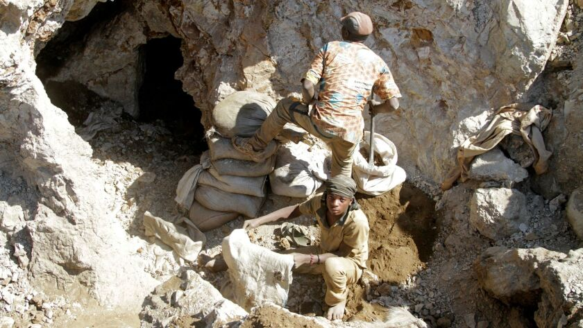 FILE PHOTO:Artisanal miners work at the Tilwizembe outside of Kolwezi