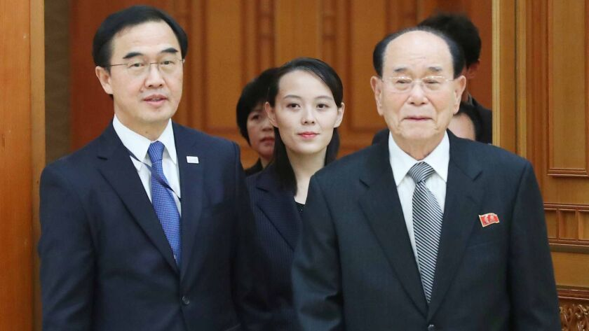 Kim Yo Jong, center, the sister of Kim Jong Un, and North Korea's ceremonial head of state Kim Yong Nam, right, are guided by South Korea Unification Minister Cho Myoung-gyon in Seoul.