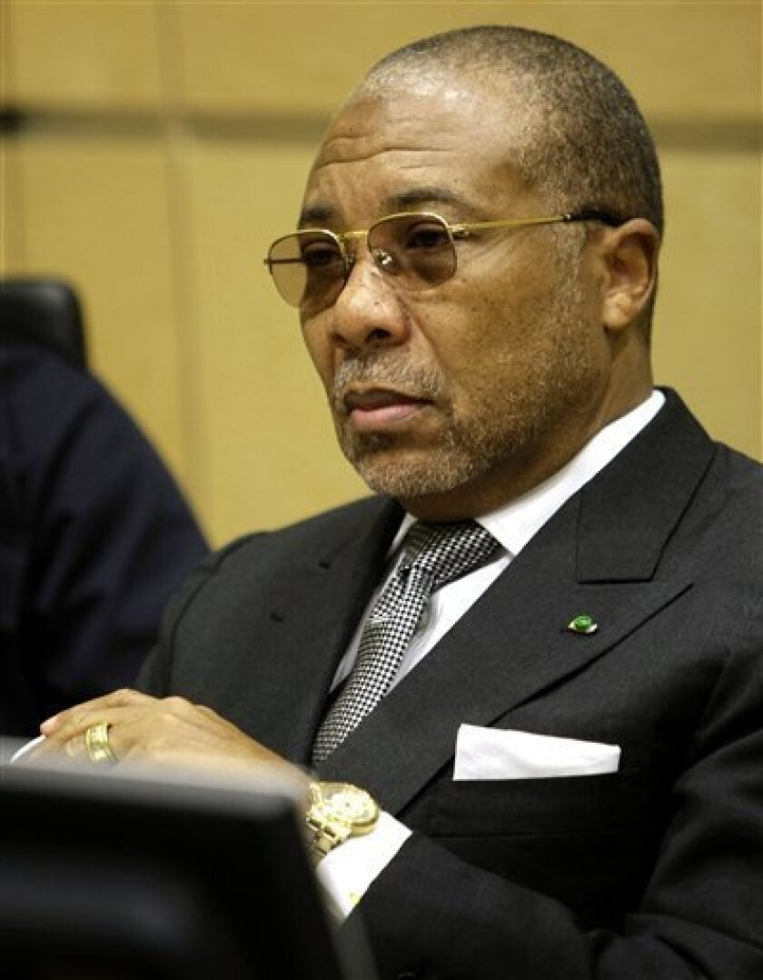 FILE - In this Jan. 7, 2008 file photo former Liberian President Charles Taylor is seen in court as his trial reopened at the U.N.-backed Special Court for Sierra Leone in The Hague, Netherlands. Prosecutors at the UN-backed court for Sierra Leone say Monday, July 6, 2009, the trial of Charles Taylor could take up to four more years if his lawyers call all their witnesses. Taylor is due to begin his defense case next week to 11 charges of war crimes and crimes against humanity in Sierra Leone. (AP Photo/Michael Kooren, Pool, File)