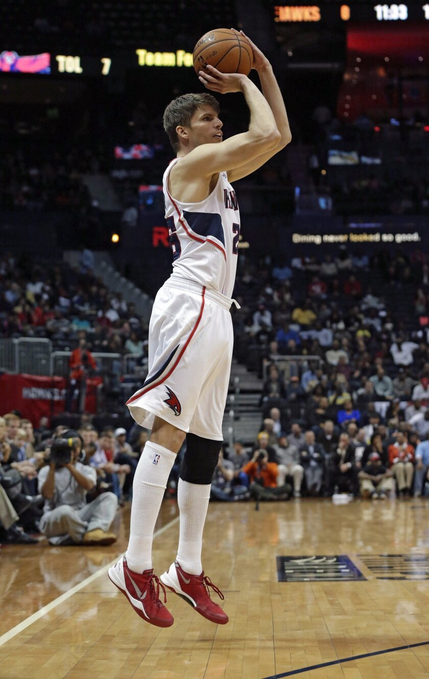 Atlanta Hawks shooting guard Kyle Korver (26) hits a three-point basket to tie the NBA record for consecutive games with a three pointer in the first half of an NBA basketball game against the Los Angeles Clippers Wednesday, Dec. 4, 2013, in Atlanta. (AP Photo/John Bazemore)