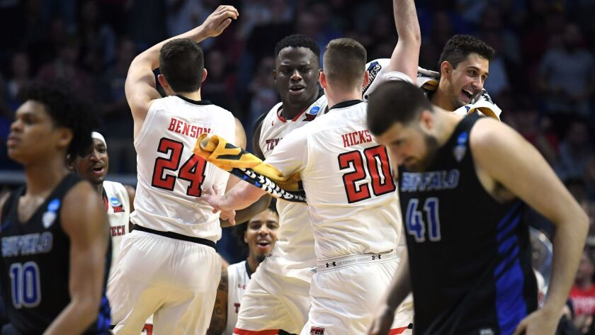 Texas Tech players celebrate their 78-58 victory over Buffalo in the second round of the NCAA tournament.