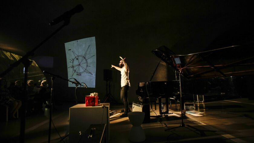 """Pianist Adam Tendler with the score of Toru Takemitsu's """"Corona"""" during a concert timed with the Jasper Johns exhibition """"Something Resembling Truth"""" at the Broad museum in downtown L.A."""