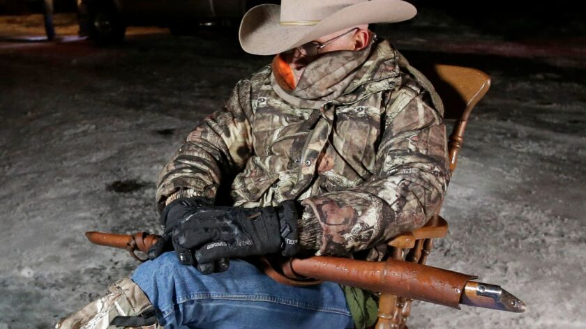 Arizona rancher LaVoy Finicum holds a rifle as occupies the Malheur National Wildlife Refuge near Burns, Ore., on Jan. 5.