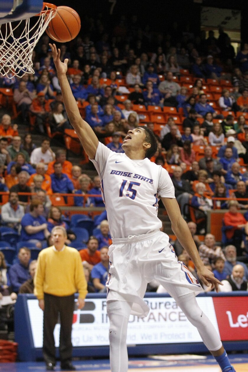 Boise State's Chandler Hutchison goes for a layup during the first half of an NCAA college basketball game against Wyoming in Boise, Idaho, on Saturday, Feb. 13, 2016. (AP Photo/Otto Kitsinger)