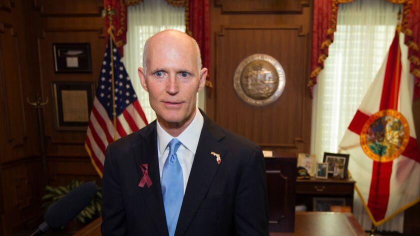 Florida Gov. Rick Scott talks to the media on March 9.