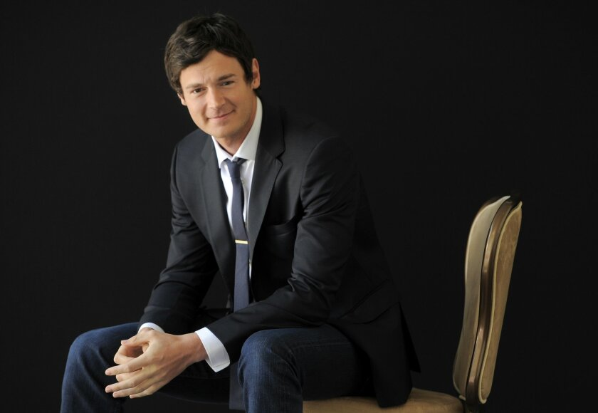 """FILE - In this July 25, 2013 file photo, actor Benjamin Walker poses for a portrait in Beverly Hills, Calif. Producers said Thursday, July 23, 2015 that the musical """"American Psycho,"""" based on Bret Easton Ellis's novel and starring Walker, will find a home in a yet-unnamed Shubert Theatre this winter, with previews starting Feb. 19. (Photo by Chris Pizzello/Invision/AP, File)"""