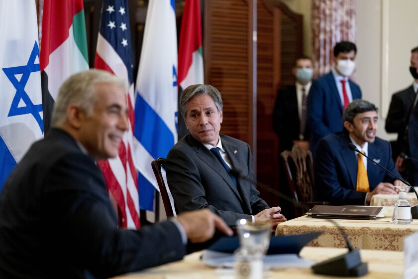 Secretary of State Blinken sits with Foreign Ministers Yair Lapid of Israel and Sheikh Abdullah bin Zayed al Nahyan of UAE.