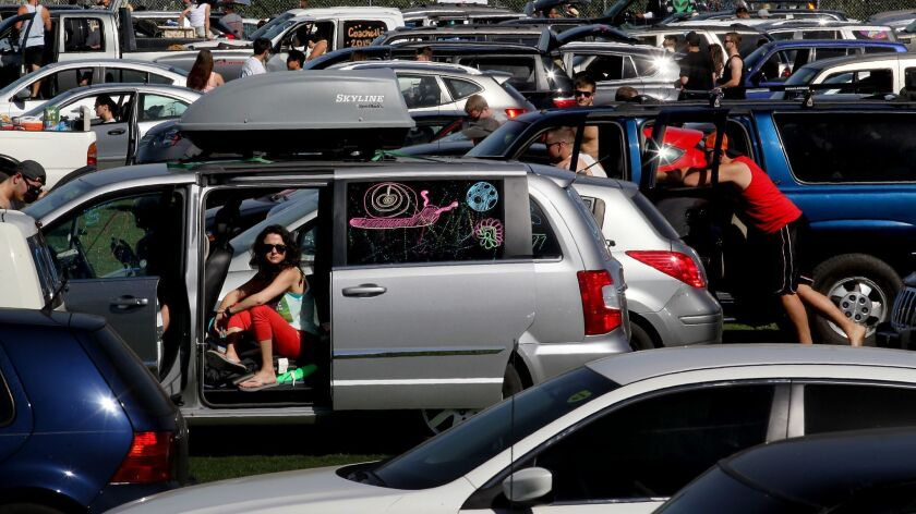 INDIO, CALIF. - APR. 9, 2015. A horde of cars and people descend on the Empire Polo Grounds in Indi