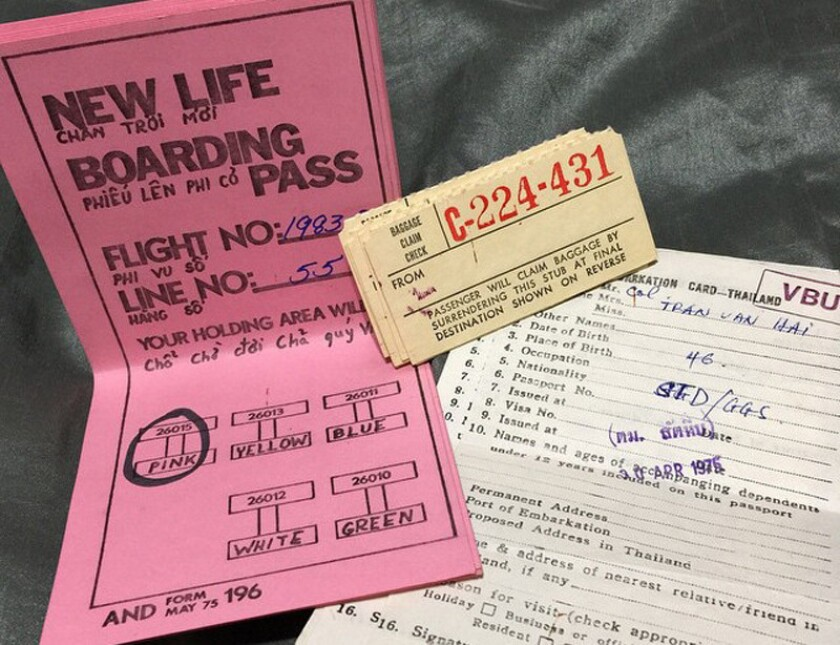 Boarding papers and baggage claim tickets for a flight from Thailand to Guam, and eventually to Ontario, Calif.