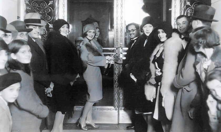 Actress Norma Shearer opens the doors of the original Central Casting building circa 1929. Major studios launched it to centralize the extras-casting process.