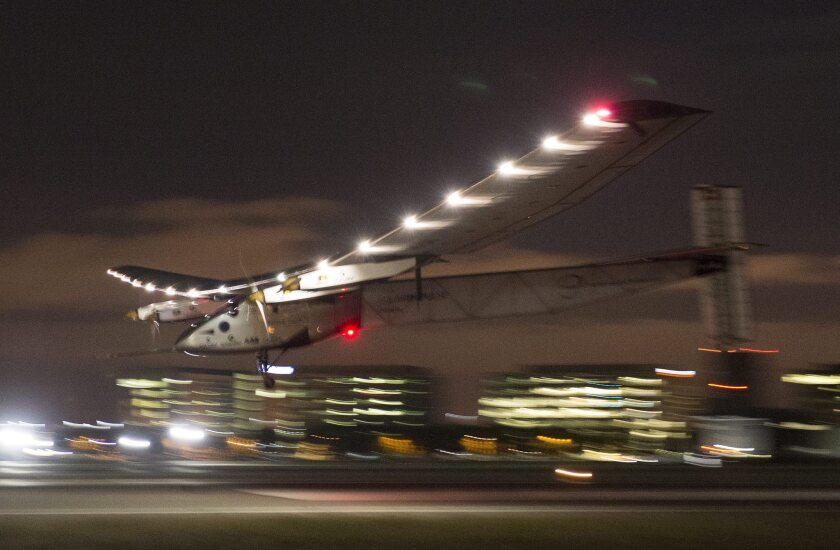 Solar Impulse 2, a solar powered plane piloted by Swiss adventurer Bertrand Piccard, lands just before midnight at Moffett Field in Mountain View on Saturday.