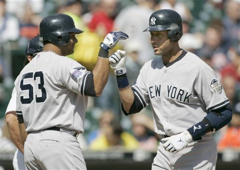 New York Yankees' Derek Jeter, right, celebrates his solo home run in the first inning with teammate Bobby Abreu (53) in a baseball game against the Detroit Tigers Saturday, May 10, 2008, in Detroit. (AP Photo/Duane Burleson)