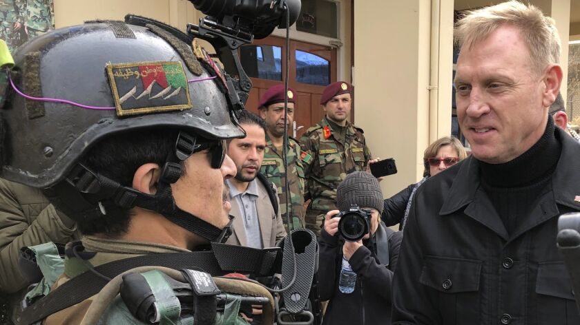 Acting Defense Secretary Pat Shanahan greets an Afghan commando on Feb. 11.