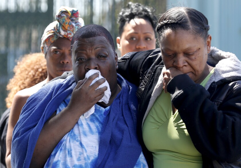 Beverly Owens, the mother of bicyclist Frederick Frazier, is overcome with emotion. Her son was struck and killed while riding his bicycle near Manchester and Normandie avenues in South L.A. in April.