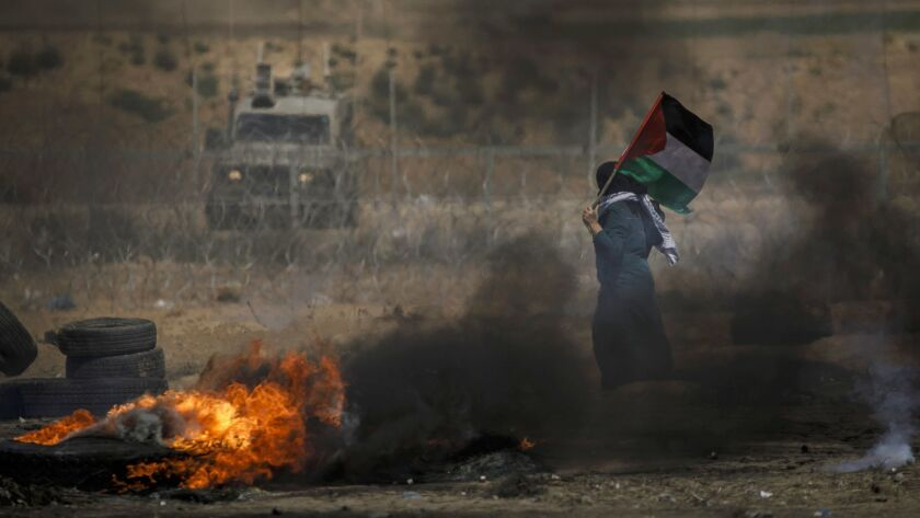 KHAN YOUNIS, GAZA STRIP -- FRIDAY, MAY 11, 2018: A Palestinian woman marches around with the Palesti