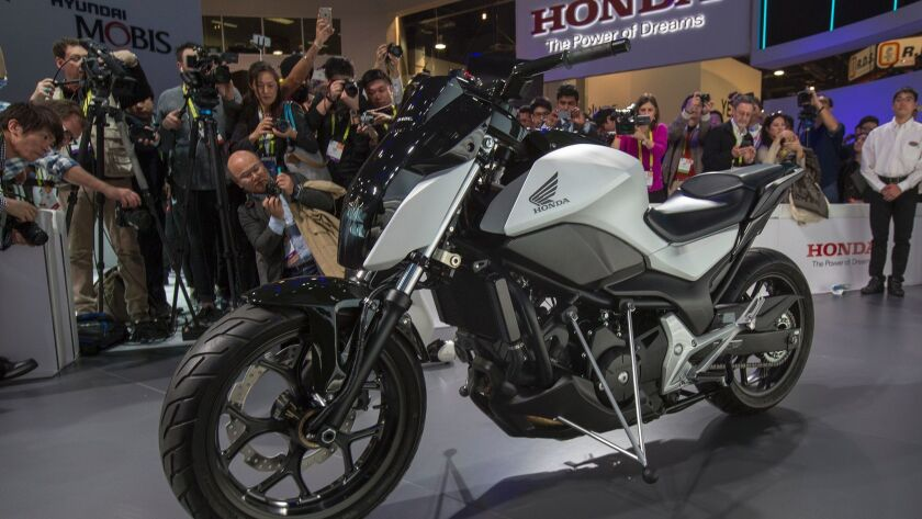 People look at the new Riding Assist concept motorcycle during the recent CES at the Las Vegas Convention Center. This is not necessarily the type of motorcycle that might be subject to a noise tax.