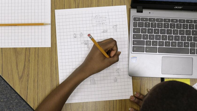 A student works on math problems in Annapolis, Md. on Feb. 12, 2015.