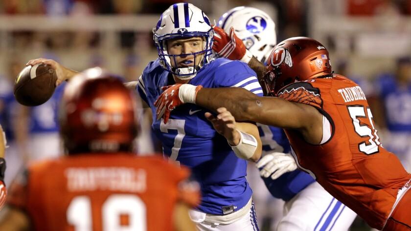 Utah defensive end Pita Taumoepenu hits BYU quarterback Taysom Hill (7) as he throws in the second half.