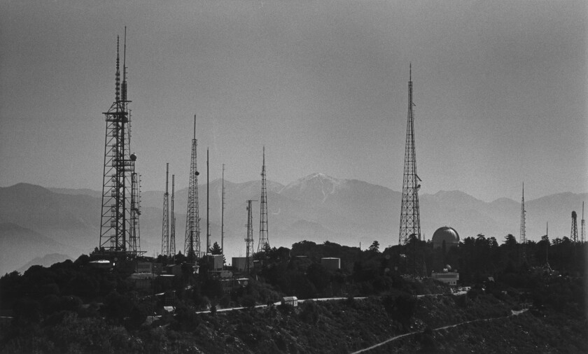 The top of Mt. Wilson bristles with a variety of broadcast towers that are hundreds of feet high. The array includes lower solar towers belonging to the Mt. Wilson Observatory on the right.