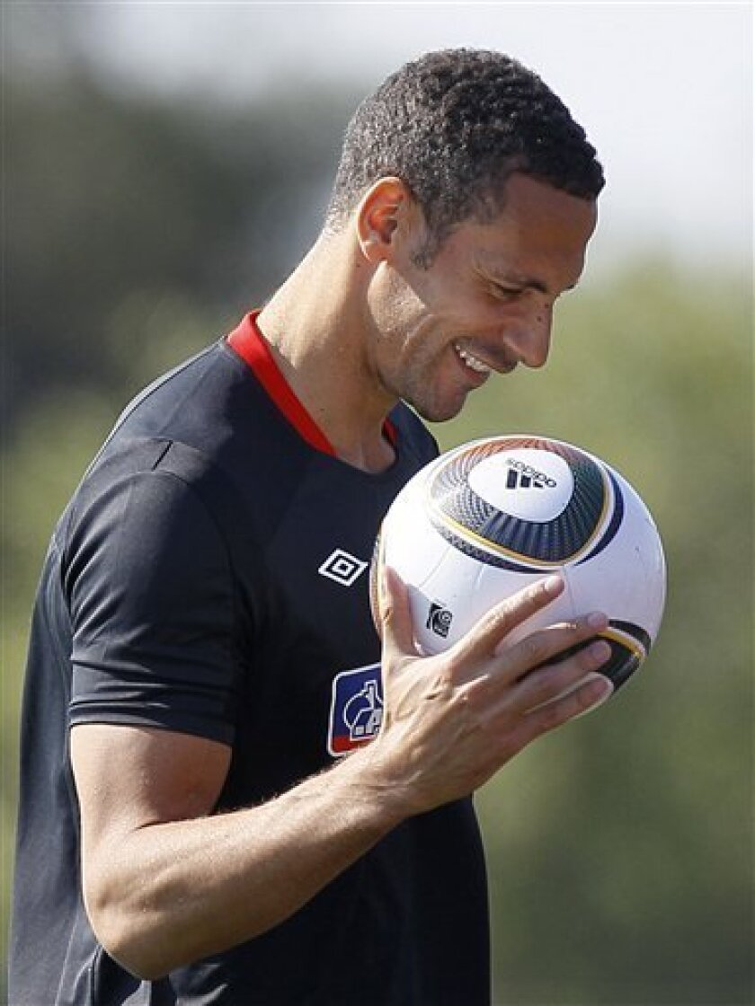 England soccer player Rio Ferdinand during a training session at Royal Bafokeng Sports Complex where the England soccer team are based, near Rustenburg, South Africa, Friday June 4, 2010. Ferdinand has gone to hospital for a scan on his left knee following a tackle in the training session. (AP Photo/Kirsty Wigglesworth)