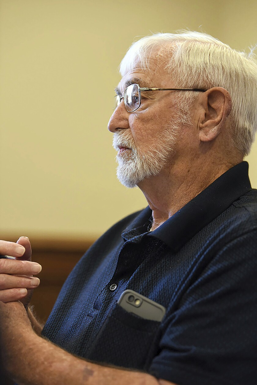 "Lowndes County supervisor Harry Sanders listens as Bishop Scott Volland, unseen, asks the county to consider removing a Confederate monument from the courthouse lawn during a Lowndes County Board of Supervisors meeting, Monday, June 15, 2020, in Columbus, Miss. After rejecting a proposal to move the monument, Sanders said this week that African Americans ""became dependent"" during slavery and have had a harder time ""assimilating"" into American life as other groups who have been mistreated have. His remark has prompted calls for his resignation. (Claire Hassler/The Commercial Dispatch, via AP)"