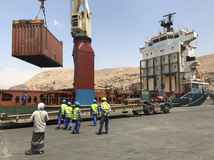 A shipment of rice and sugar is unloaded at the port in Mukalla, Yemen.