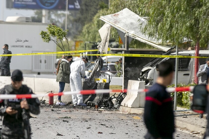 Forensic officers work on a blast site near the U.S. Embassy in Tunis on Friday.
