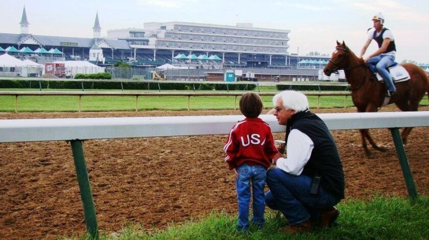 Trainer Bob Baffert, here with his son, Bode, at Churchill Downs, is a finalist for an Eclipse Award as top trainer in 2013.