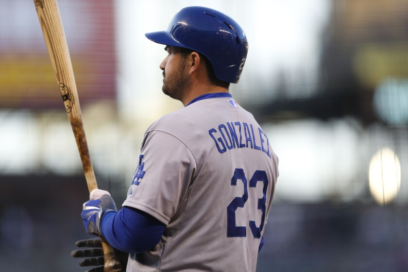 Dodgers first baseman Adrian Gonzalez waits to bat against the Colorado Rockies during the first inning of a game on Sept. 25.