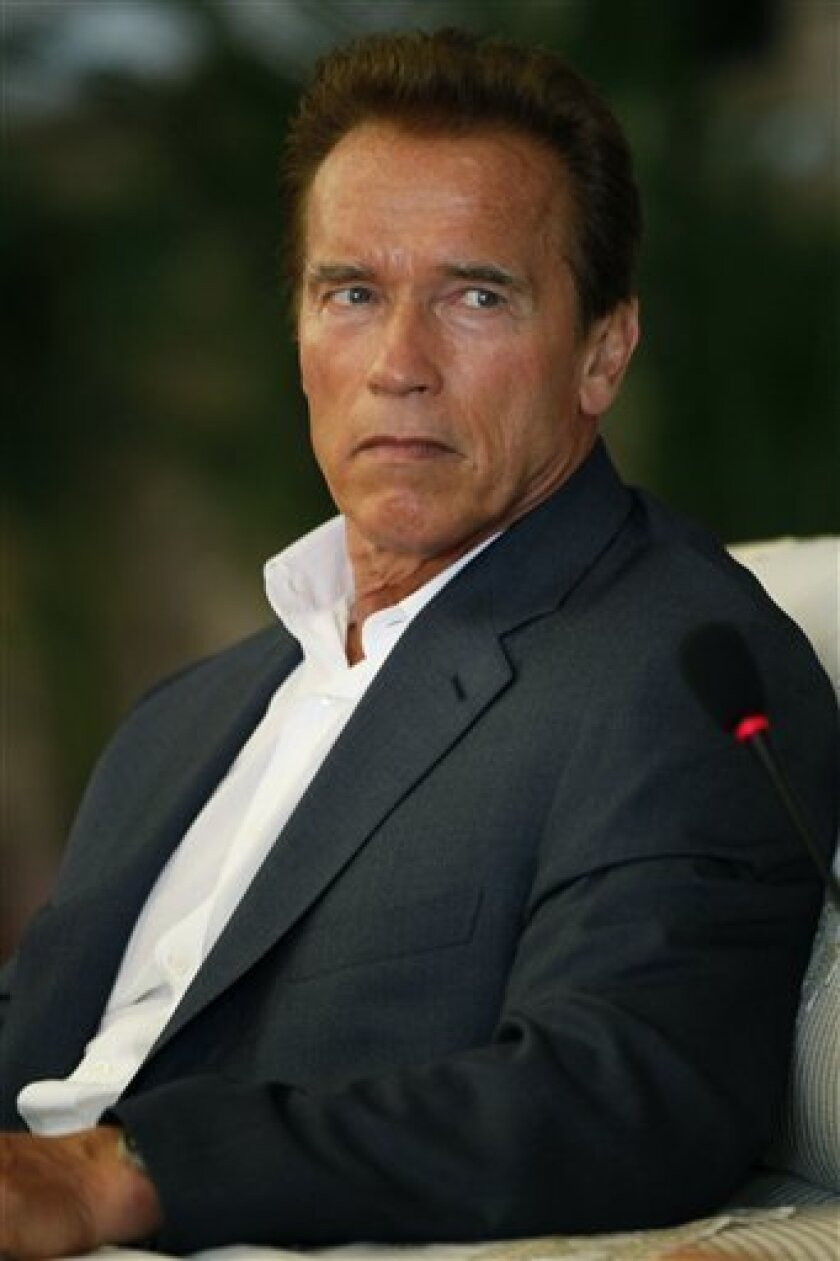 California Gov. Arnold Schwarzenegger attends a meeting with China's Ministry of Railways Vice Minister Lu Chunfang Sunday, Sept. 12, 2010, at Hongqiao Railway Station in Shanghai. (AP Photo/Eugene Hoshiko)