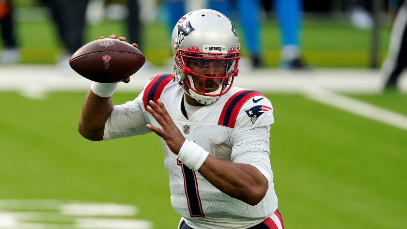 New England Patriots quarterback Cam Newton throws against the Chargers.