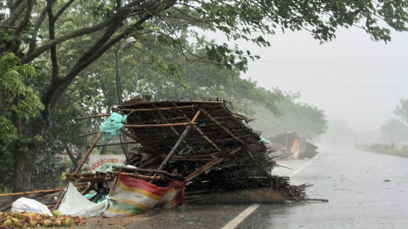Winds from Cyclone Fani topple street shops on the outskirts of Puri, India, on May 3.