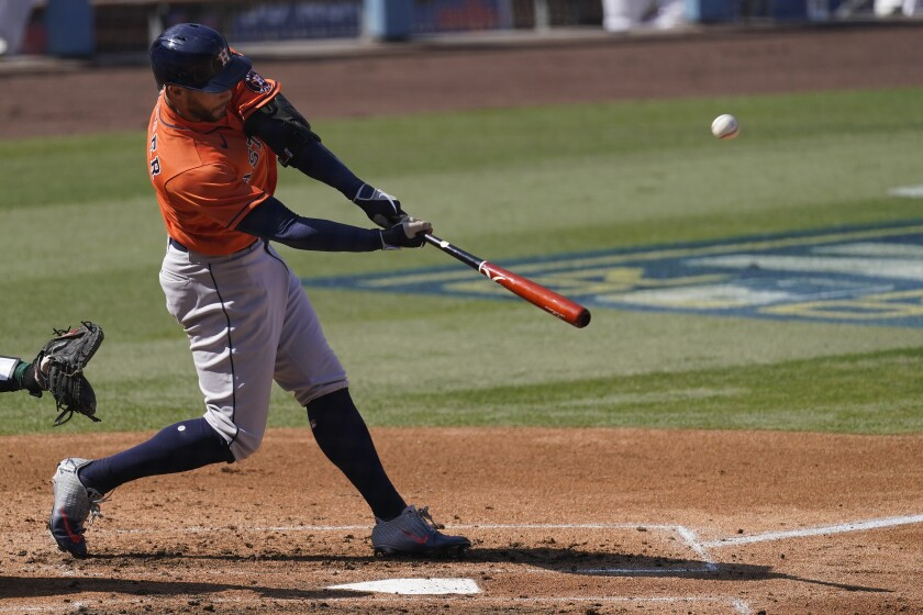 Houston Astros' George Springer hits a two-run home run against the Oakland Athletics.