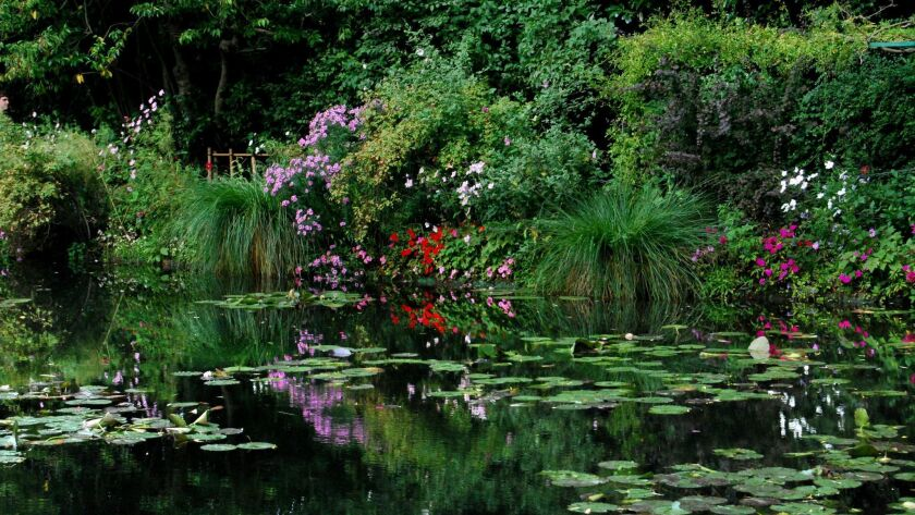 GIVERNY, FRANCE: The lily ponds that Monet made world famous, he would sit for hours on the benches