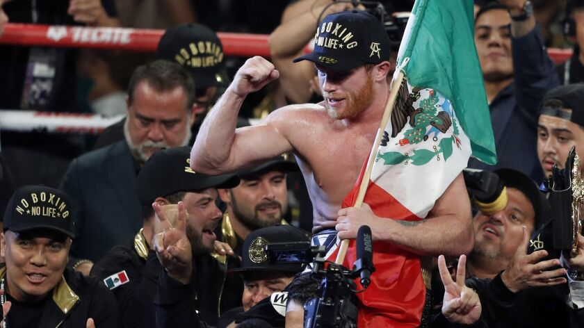 Canelo Alvarez, of Mexico, celebrates after defeating WBC/WBA middleweight champion Gennady Golovkin