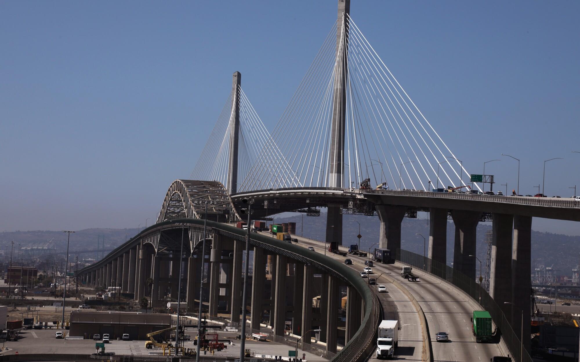 Construction workers work on the Gerald Desmond Bridge