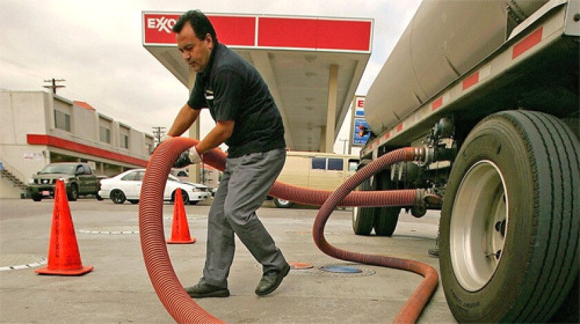 FILL 'ER UP: Marcos Moran delivers gas to an Exxon station in Burbank last week. U.S., British and Dutch courts have approved a request to block Petroleos de Venezuela from selling foreign assets