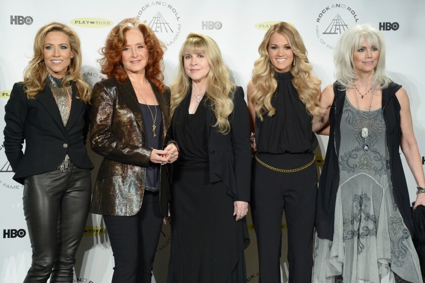 Sheryl Crow, left, is shown with Bonnie Raitt, Stevie Nicks, Carrie Underwood and Emmylou Harris at the 29th Rock and Roll Hall of Fame induction ceremony in New York in 2014.