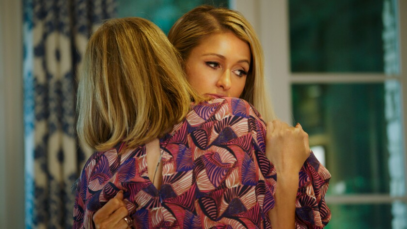 "Paris Hilton hugs her mother, Kathy, in the documentary ""This Is Paris."""
