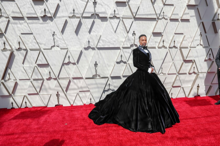 Billy Porter in his iconic tuxedo dress at the Oscars Red Carpet 2019.