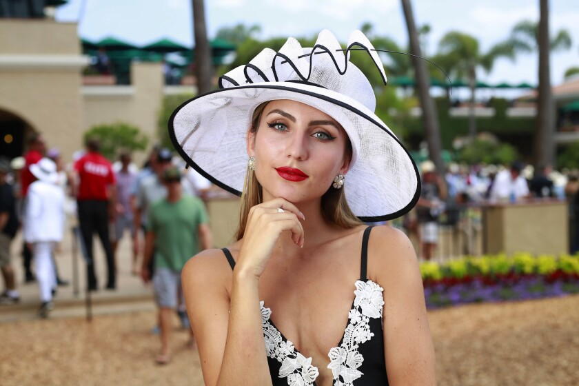 Geordyn Coker shows off her hat on Opening Day at the Del Mar Thoroughbred Club on July 19, 2017.