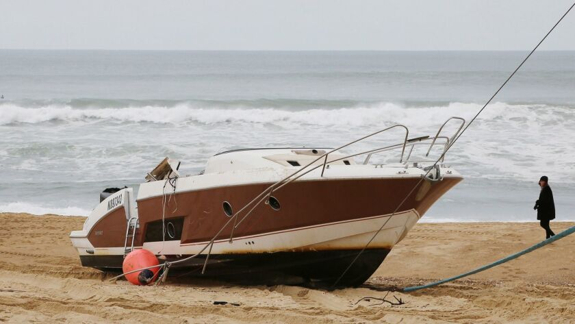 The speedboat belonging to sportswear maker Quiksilver CEO Pierre Agnes lays ashore on the beach of