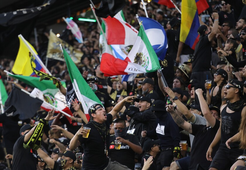 LAFC fans cheer during Sunday's game at Banc of California Stadium.