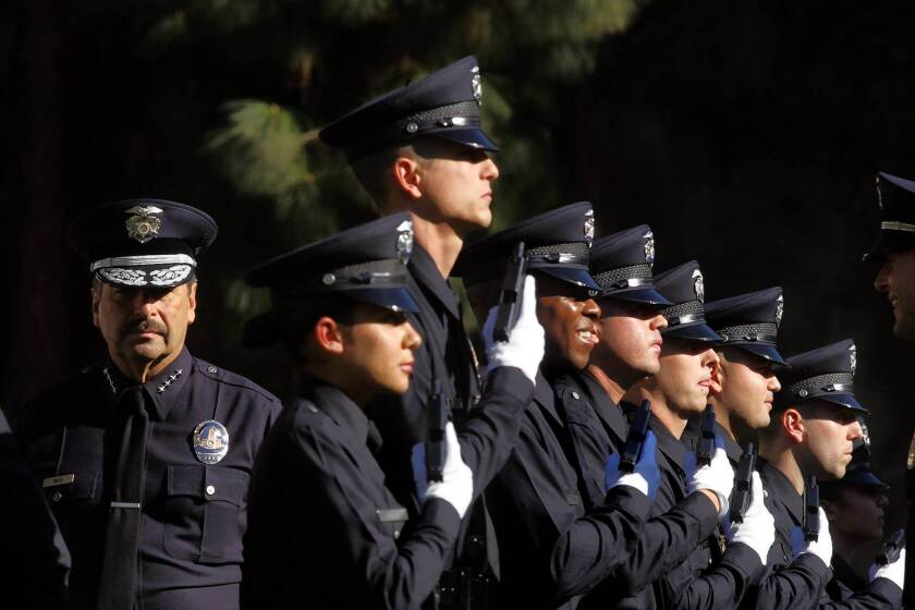 LAPD Chief Charlie Beck, left, makes the final inspection of recruit officers during a graduation ceremony. He argues that there is an important correlation between officer staffing levels and lower crime rates.