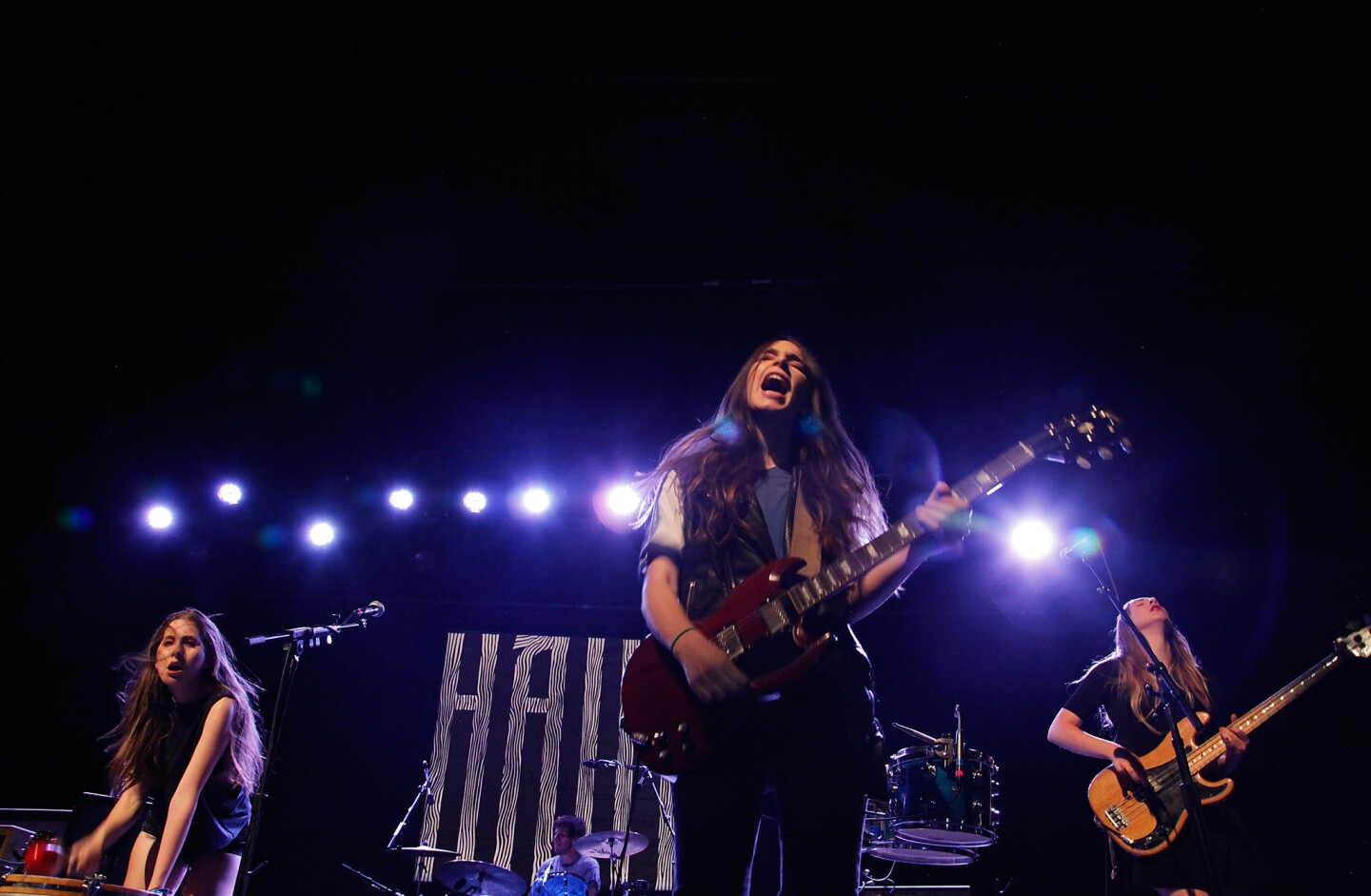 "Haim, whose debut album ""Days Are Gone"" opened at No. 1 in the U.K. and No. 6 in the U.S., played a sold-out homecoming show at the Fonda Theatre in Los Angeles on Wednesday night. Alana, left, Danielle and Este Haim grew up in the Valley. The three sisters' band includes a mister, drummer Dash Hutton."