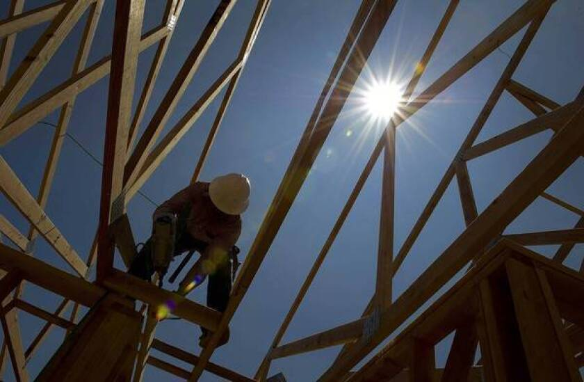 """A laborer works on a new home in Dublin, Calif. """"Construction was our biggest major drag for a long time,"""" said economist Esmael Adibi. """"But now we're coming back stronger in terms of percentages."""""""